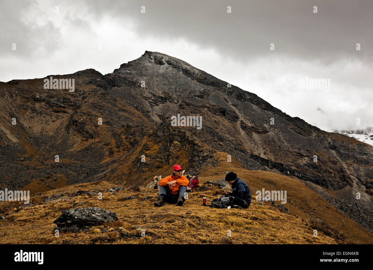 BHUTAN - Tom and assistant guide, Gembo, at vista point above trekkers Base Camp (Jangothang) (Elevation around - Stock Image