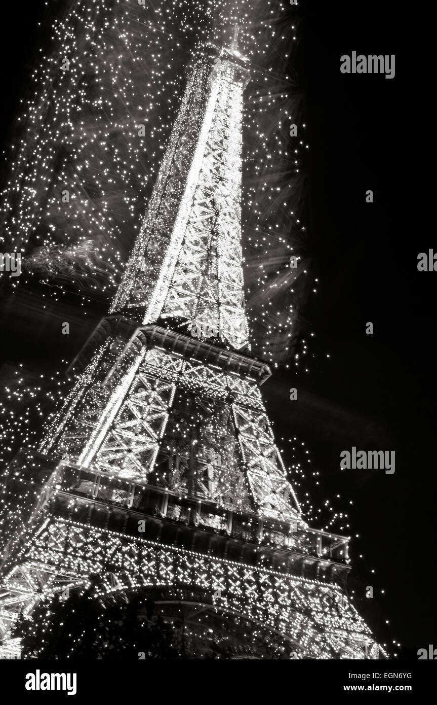 the eiffel tower at night in black and white looking magical with
