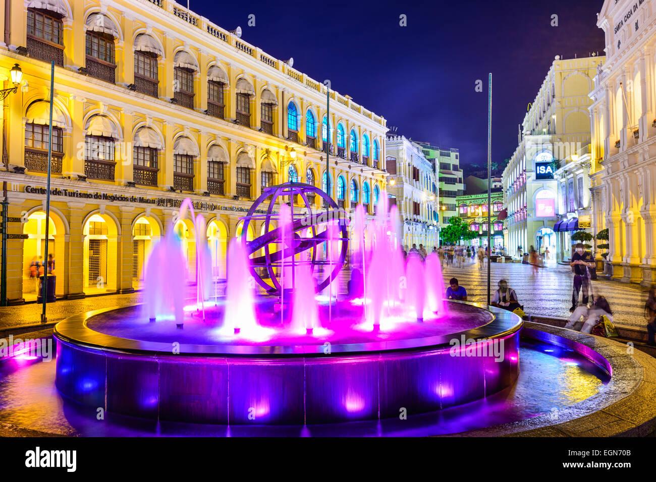 People enjoy Senado Square in Macau, China. - Stock Image