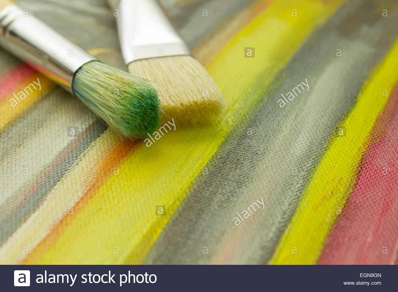 Close Up Of Pair Paintbrushes Laying On Striped Painted Painting Wallpaper