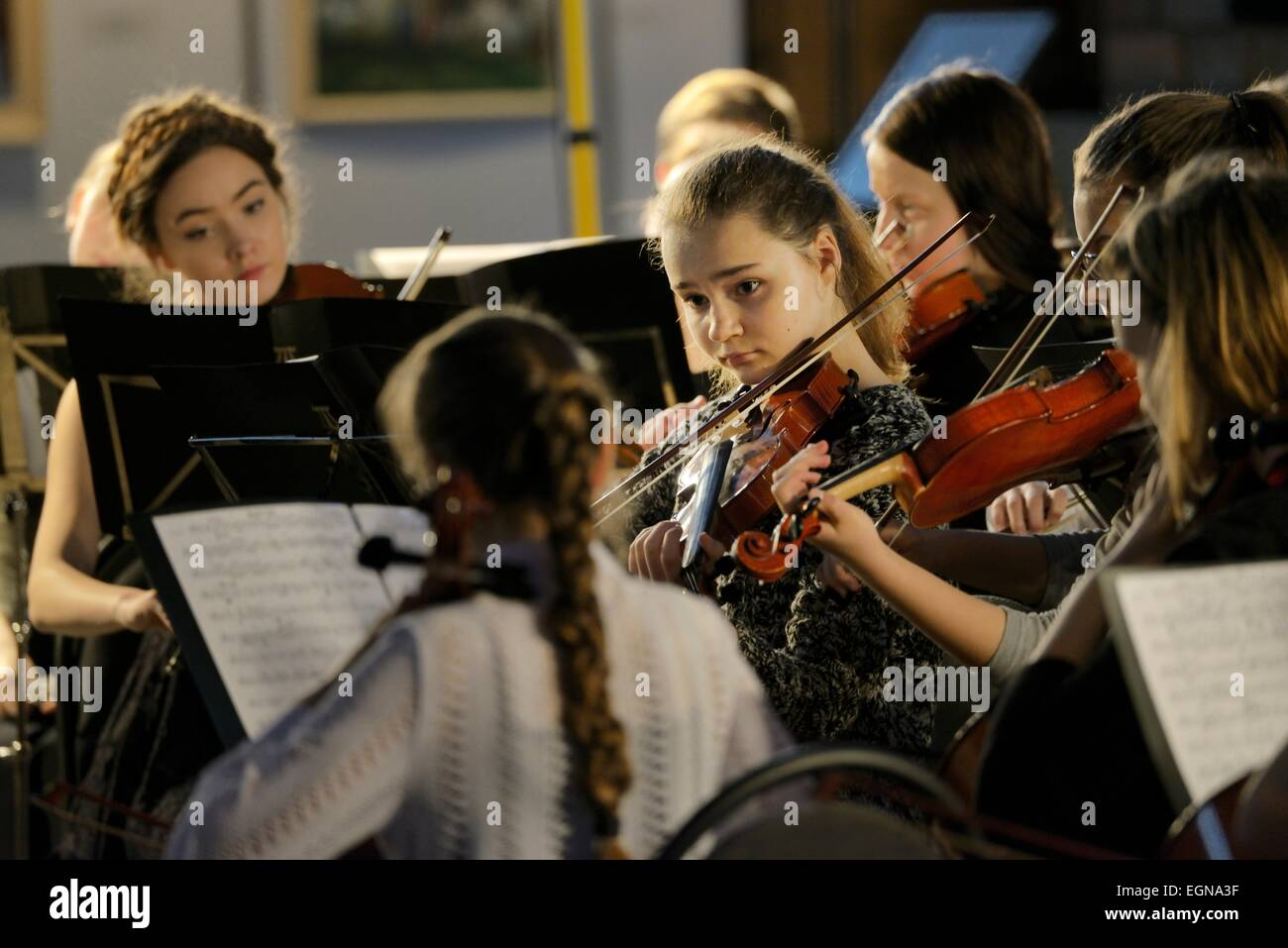 Riga Latvia. Members of youth orchestra during classical music recital inside Saint Peters Church - Stock Image