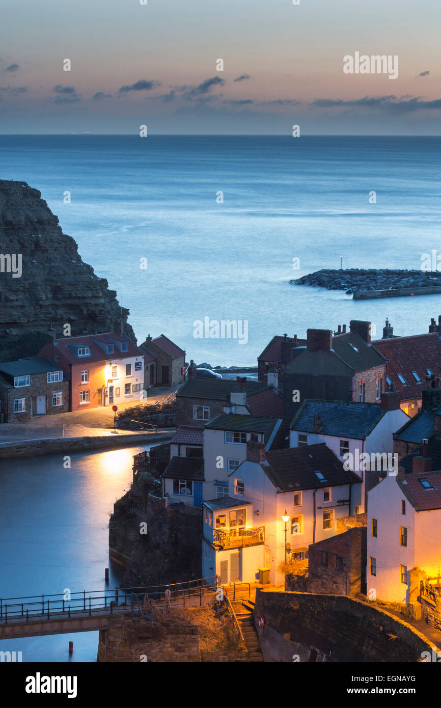 Daybreak over Staithes fishing village on the Yorkshire coast. - Stock Image