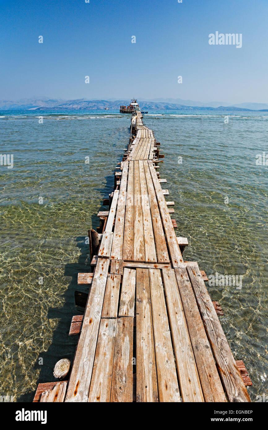 A long platform over the shallow water of Kalamaki at Corfu, Greece - Stock Image