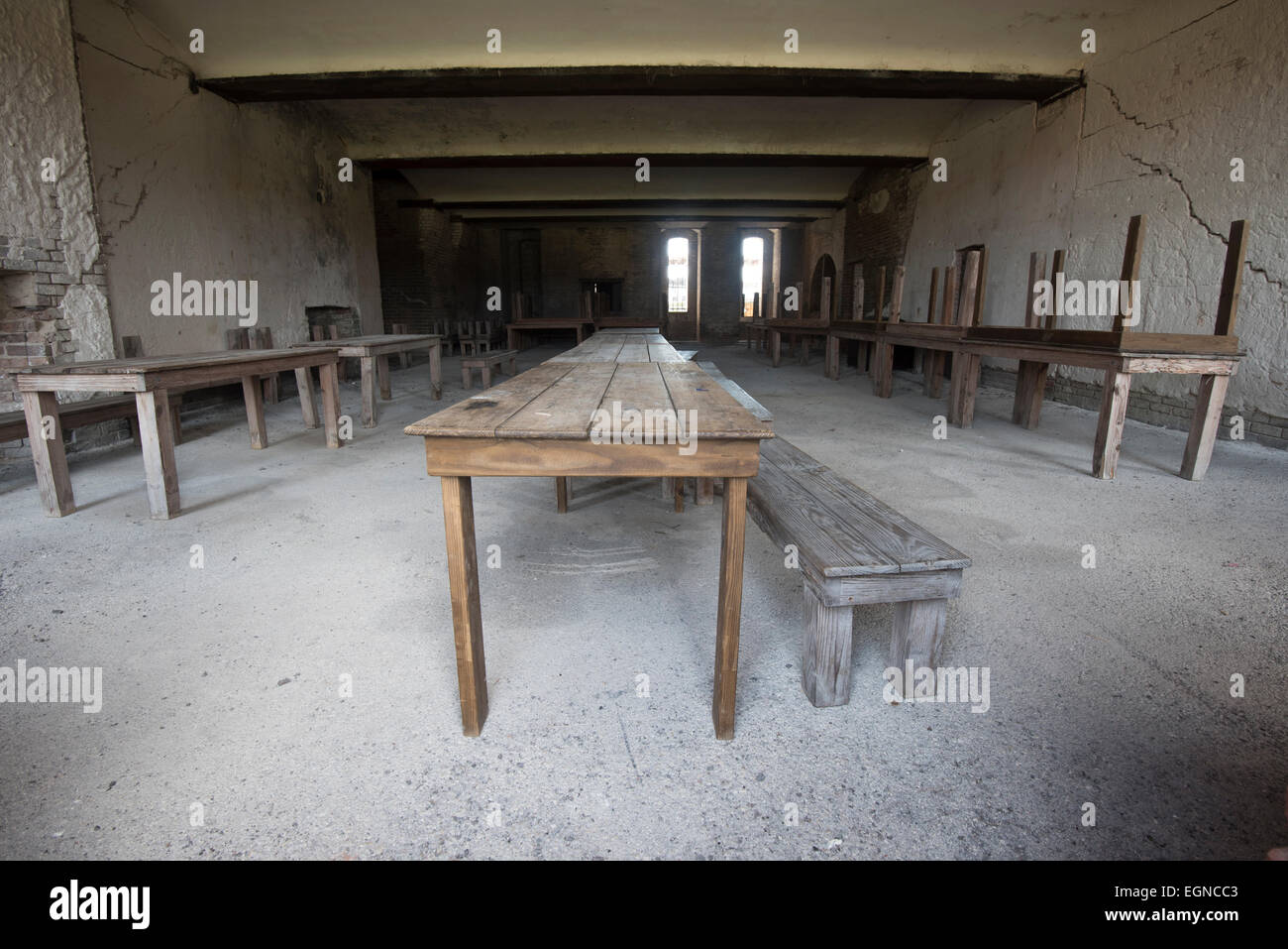 The mess hall with antique wooden tables at Fort Zachary Taylor State Historical Park - Stock Image