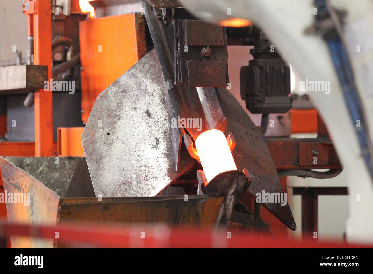 positioning unit and supplying the heated round billet - Stock Image