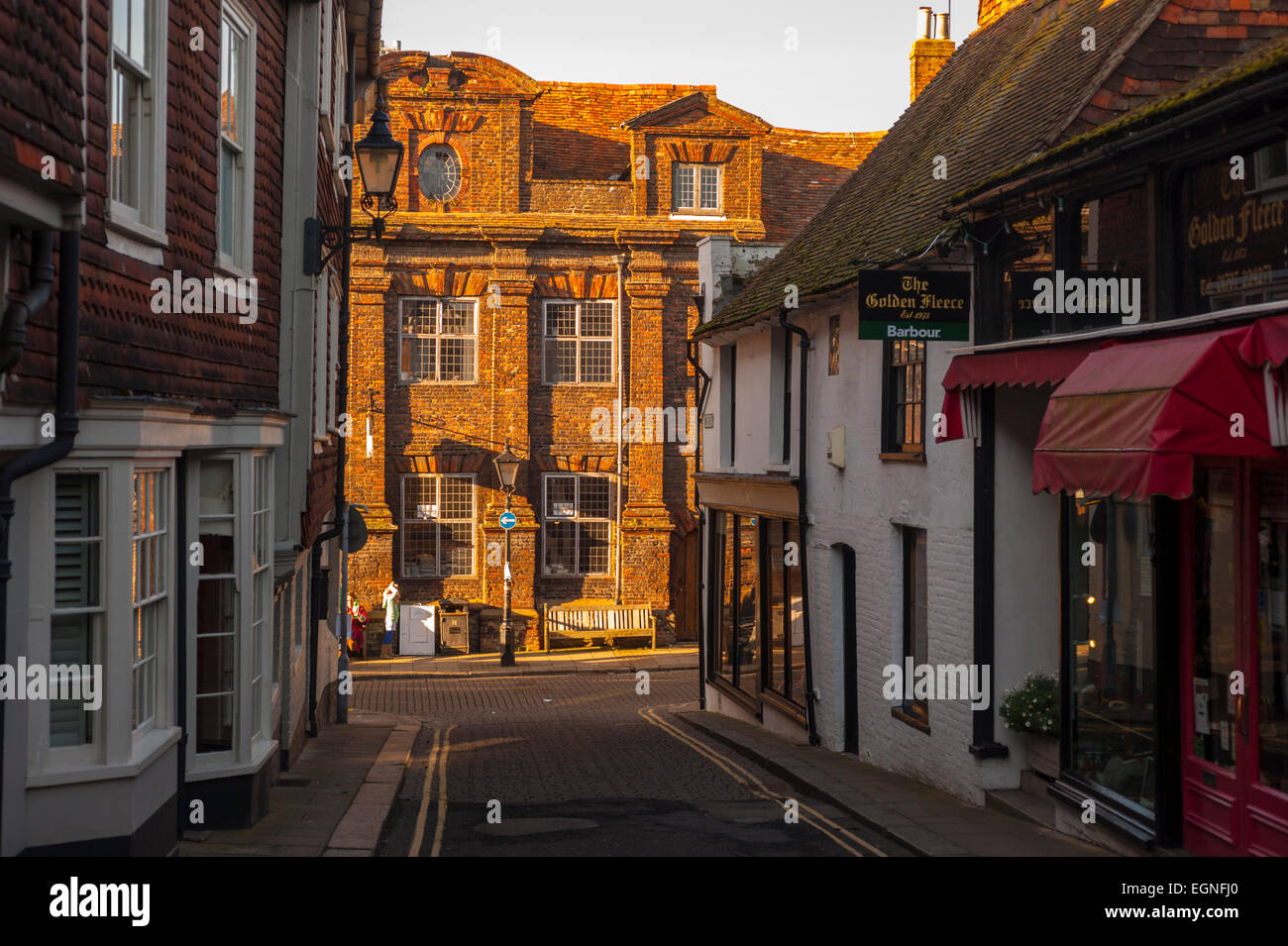 Looking down Lion street in Rye. on a late winter afternoon with the sun hitting the buildings on High Street - Stock Image
