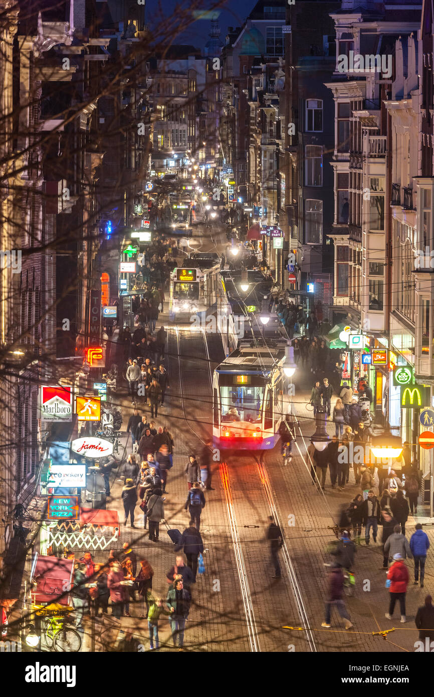 Tram in Amsterdam Leidsestraat with trams at night elevated street view - Stock Image