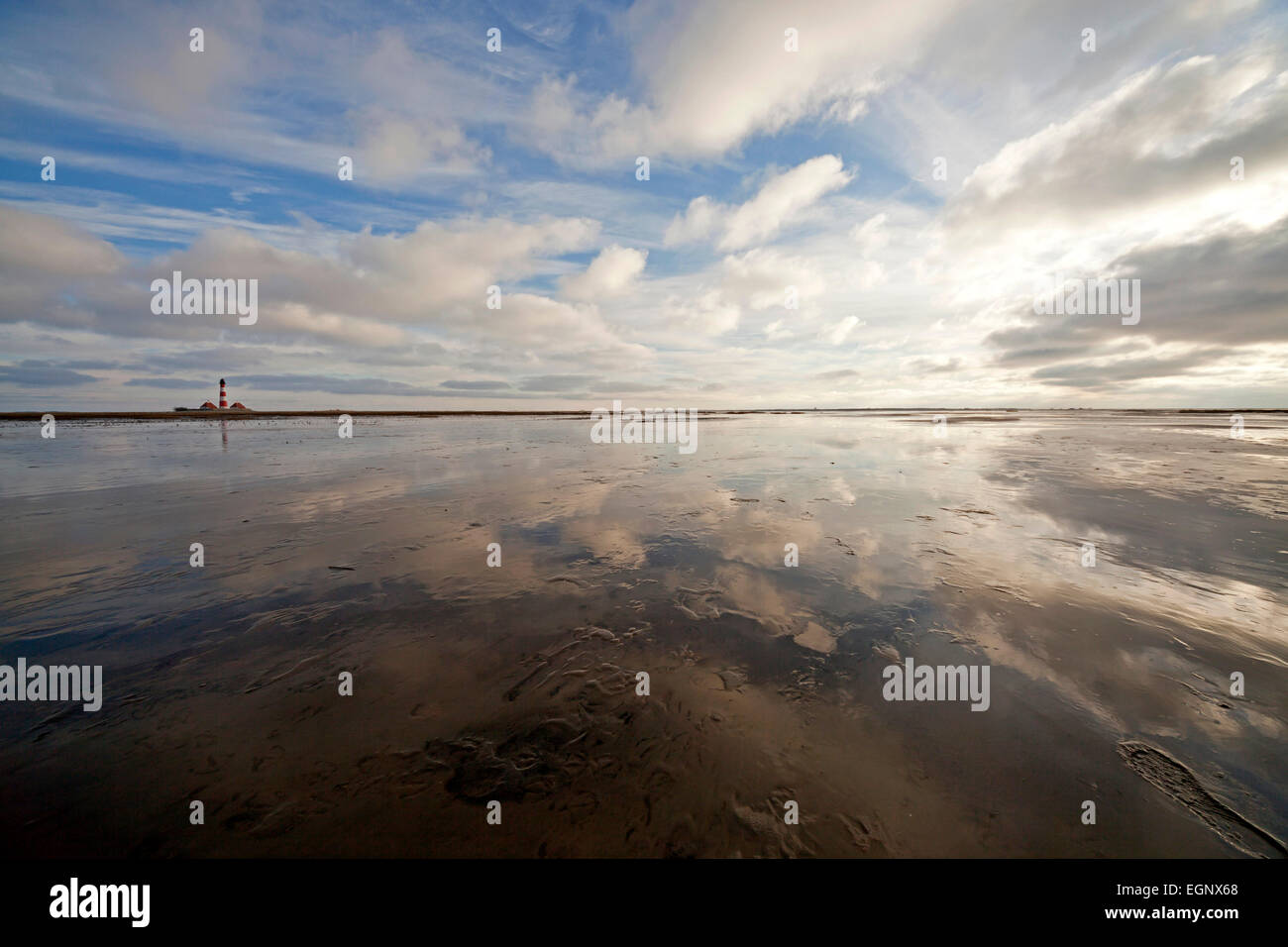 Westerheversand  lighthouse reflected in the north sea, national park Wadden Sea,  Westerhever, Schleswig-Holstein, - Stock Image