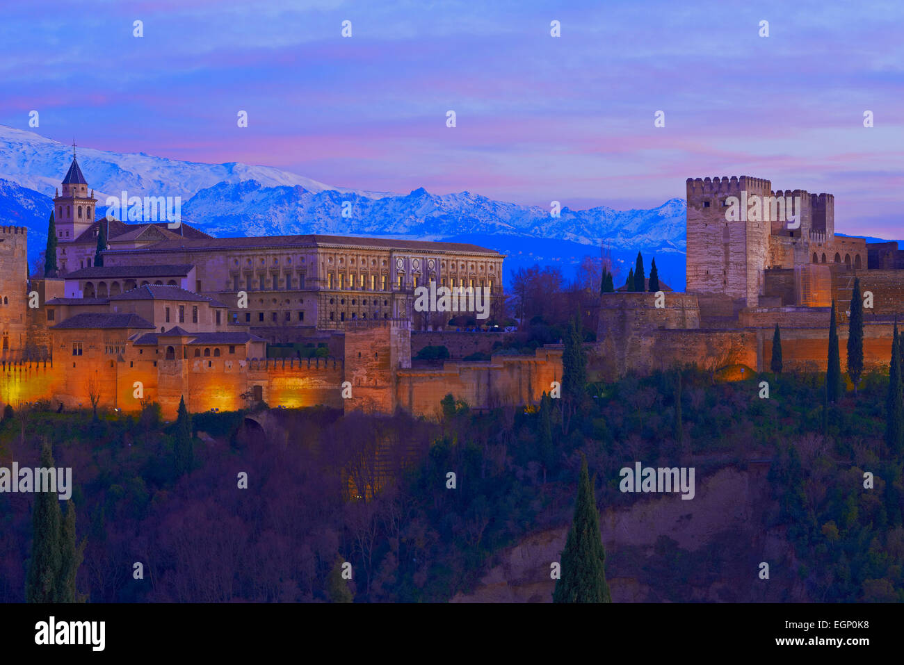 Alhambra, UNESCO World Heritage Site, Sierra Nevada and la Alhambra at Dusk, Granada, Andalusia, Spain Stock Photo