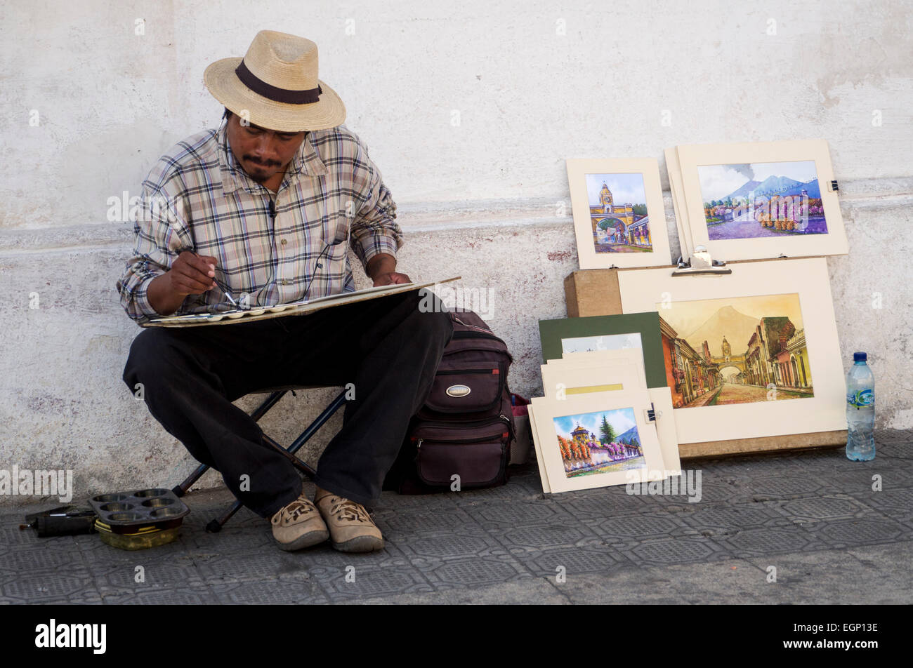 Artists paints in the old town of Antigua, Guatemala - Stock Image
