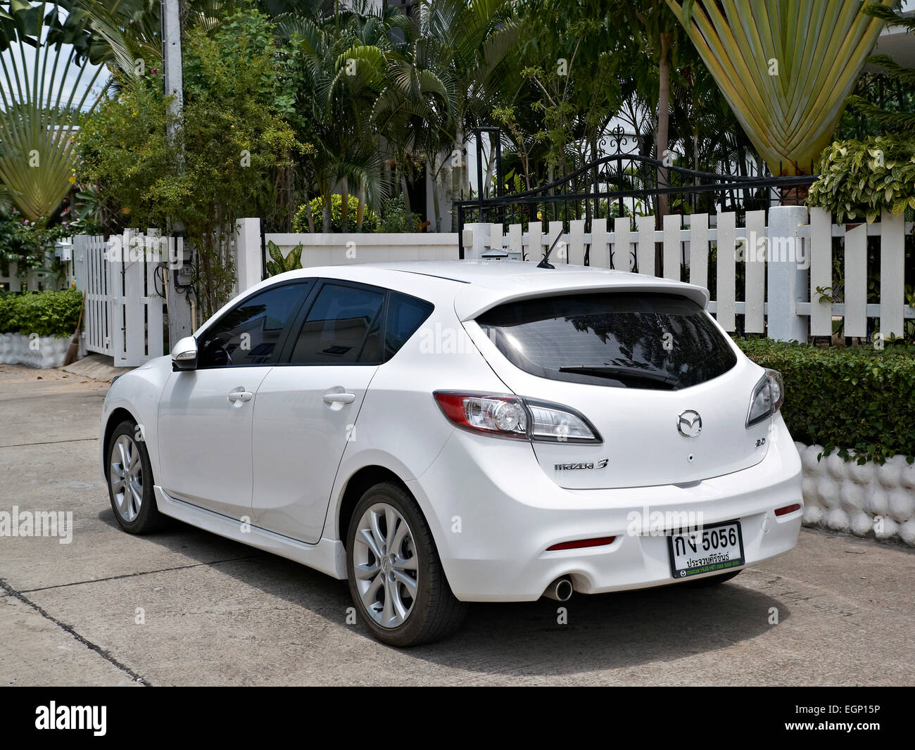 White Mazda 3 hatchback car - Stock Image