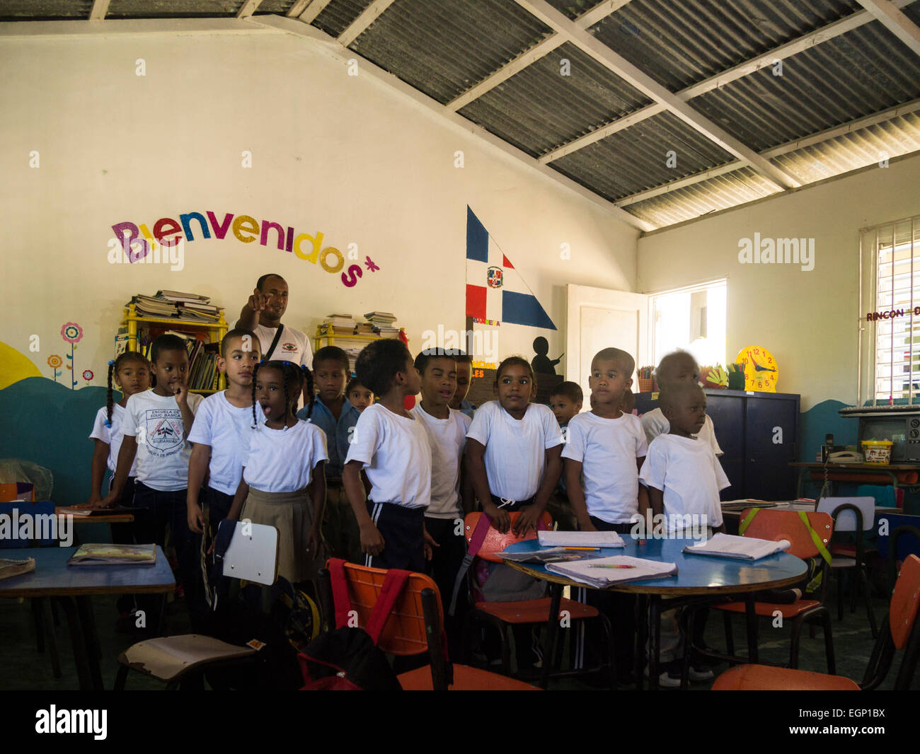 Primary school children in class entertaining tourists singing local songs  Puerto Plata Dominican Republic hoping - Stock Image