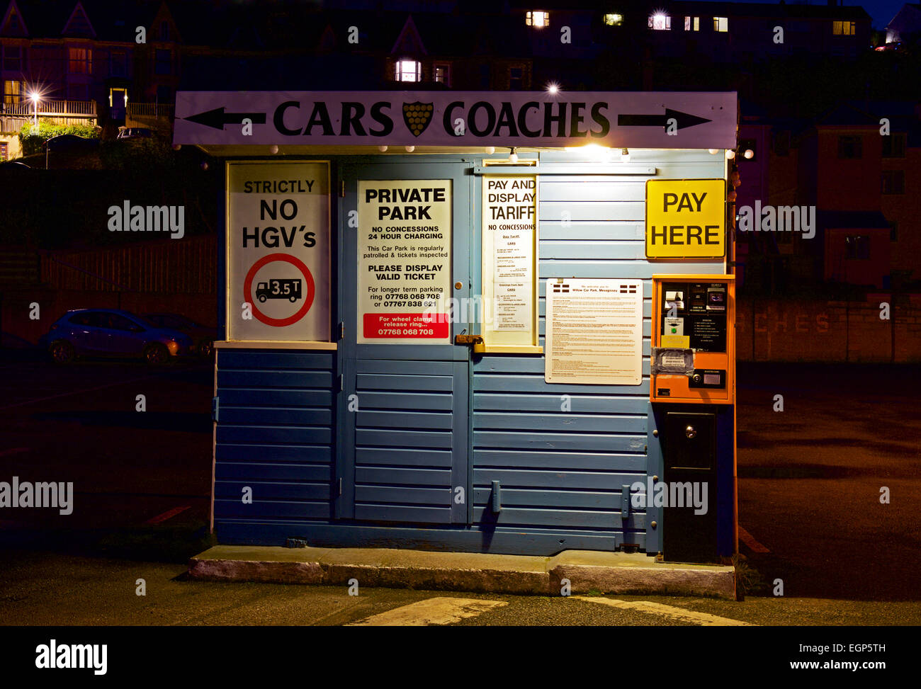 Ticket machine in car park, at night, Cornwall, England UK - Stock Image