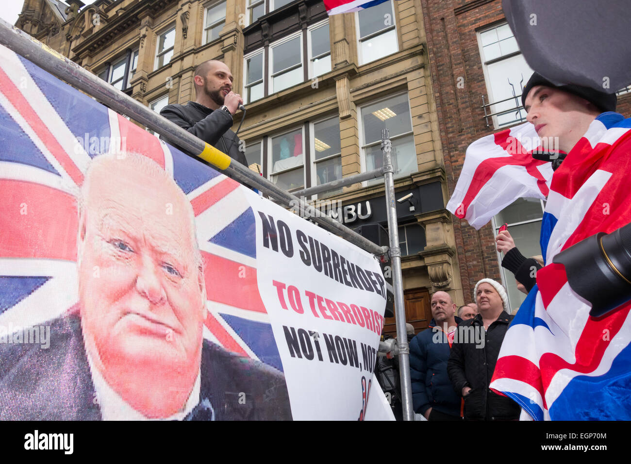 Newcastle upon Tyne, UK. 28th February, 2015. Speaker under Winston Churchill banner at first UK protest by Pegida - Stock Image