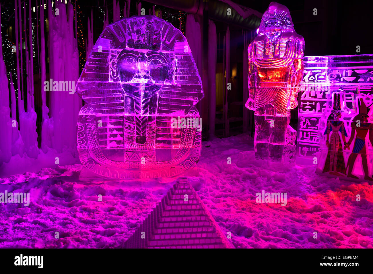 King Tut ice sculpture and burial mask with purple lights at Yorkville Village Park Icefest Toronto Cumberland street - Stock Image