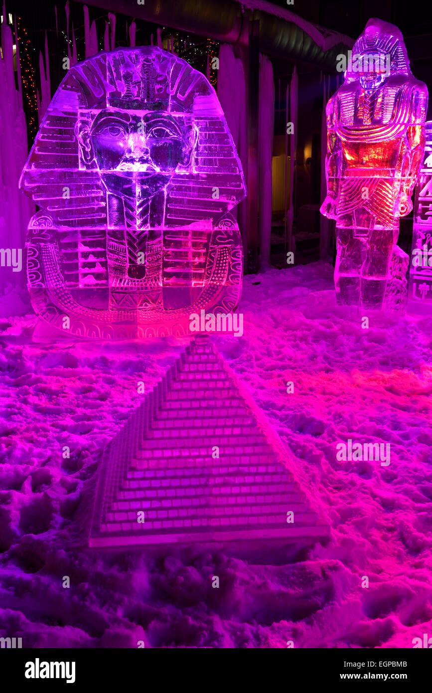 King Tut ice sculpture with pyramid and purple lights at Yorkville Village Park Icefest Toronto Cumberland street - Stock Image