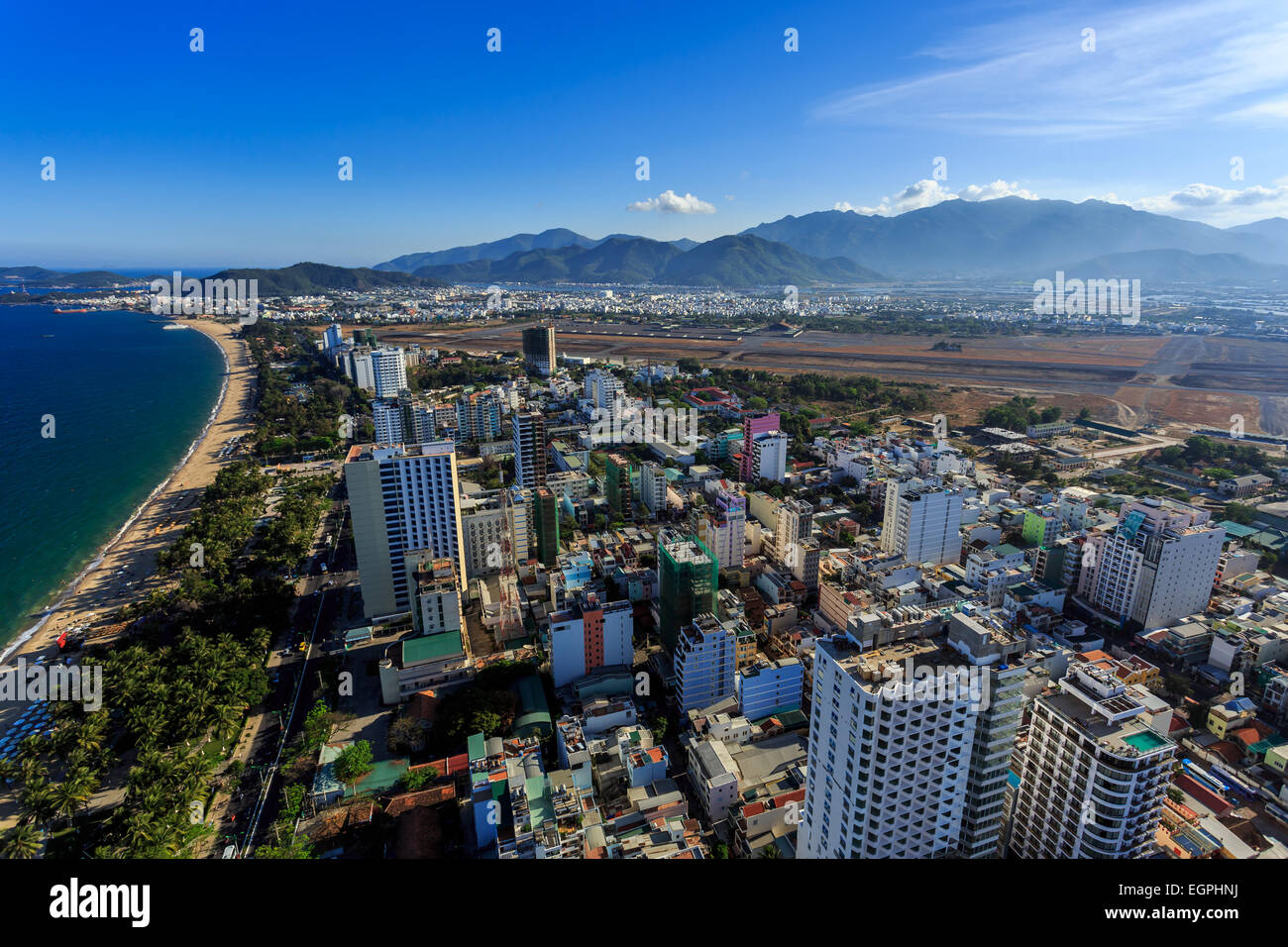 Aerial view over Nha Trang city, Vietnam taken from rooftop, extreme wide angle - Stock Image