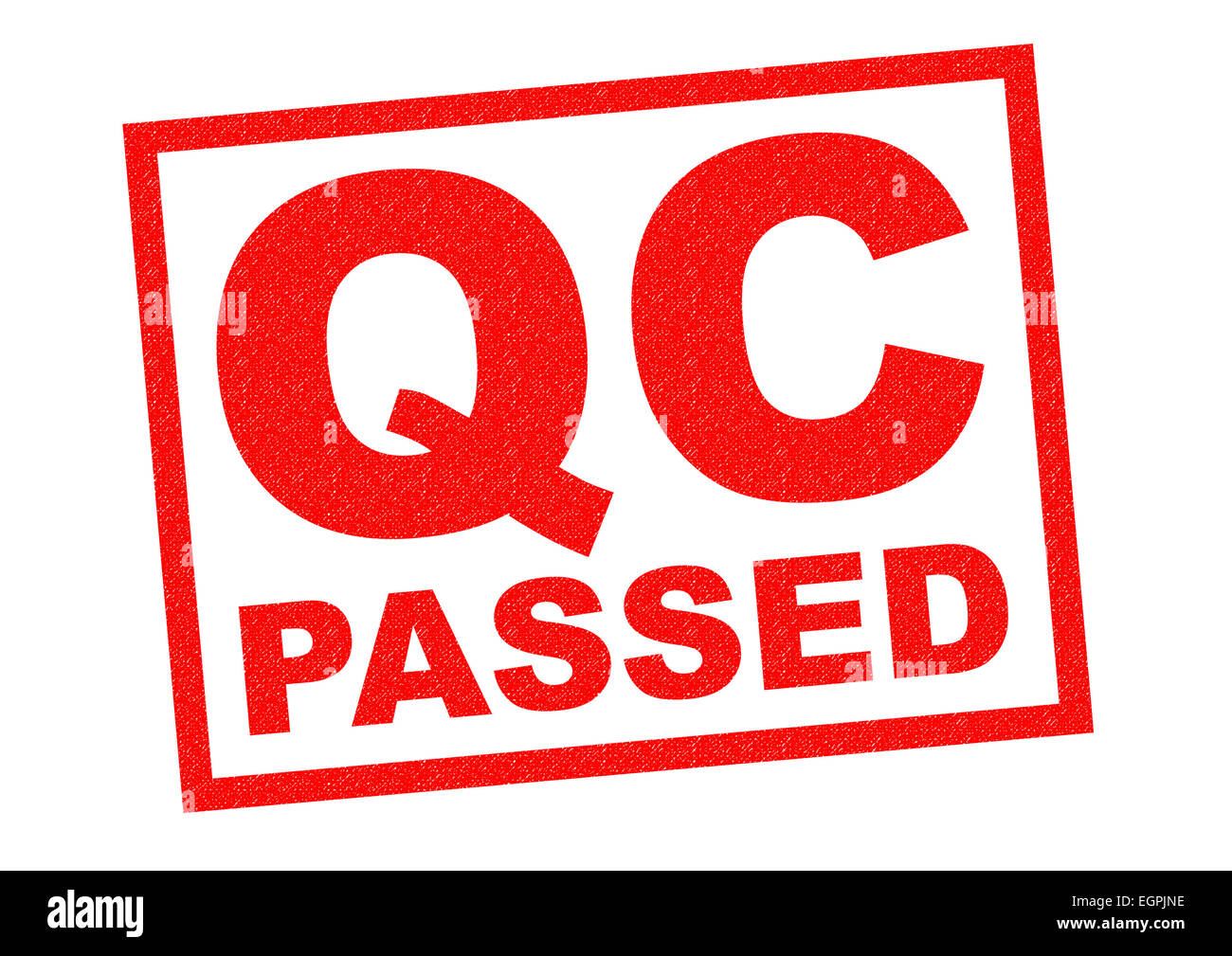 Qc passed red rubber stamp over a white background stock image
