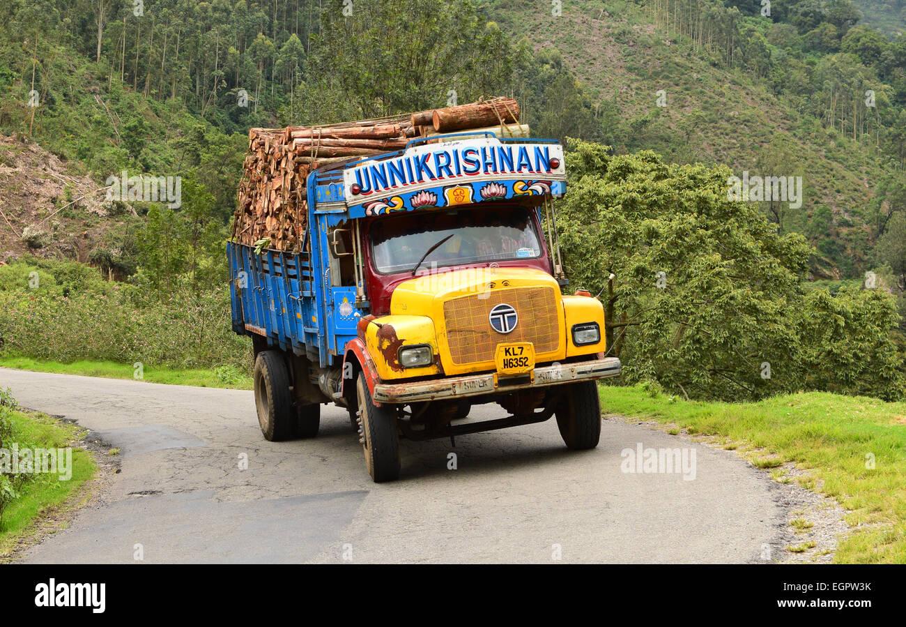 woods carrying lorry climbing down the munnar road at kerala india