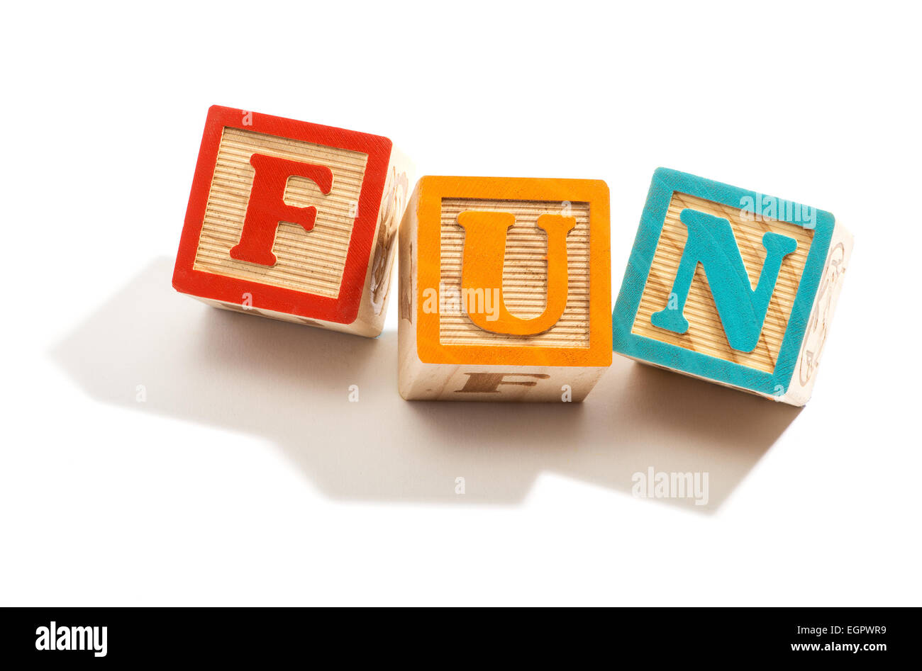 Close up fun in Colored Wooden Letter Blocks - Stock Image