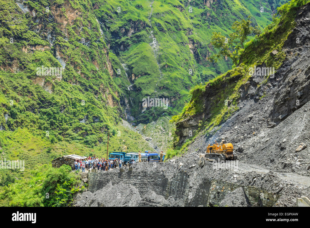 Govinghat, India - Aug 9 : The officer from Indian Highway Department clear the road that was blocking after landslide Stock Photo