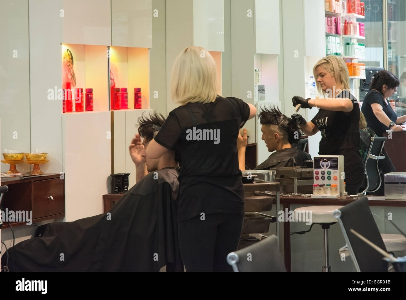 Hairdresser styling Man's hair - Stock Image