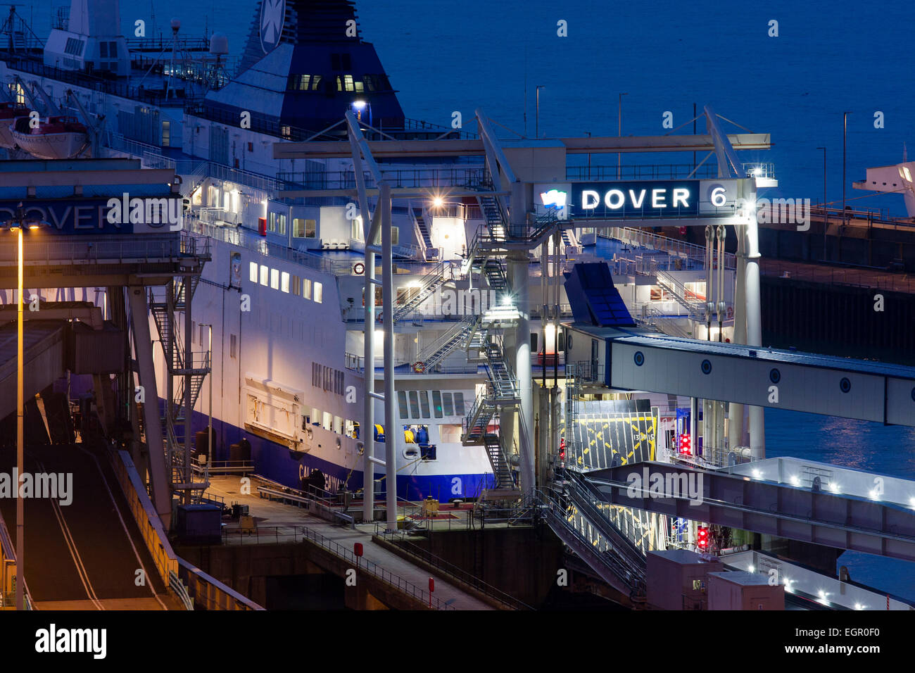 England, Dover. Docks, harbour. Night-time. Car ferry berthed at embarkation point 6 - Stock Image