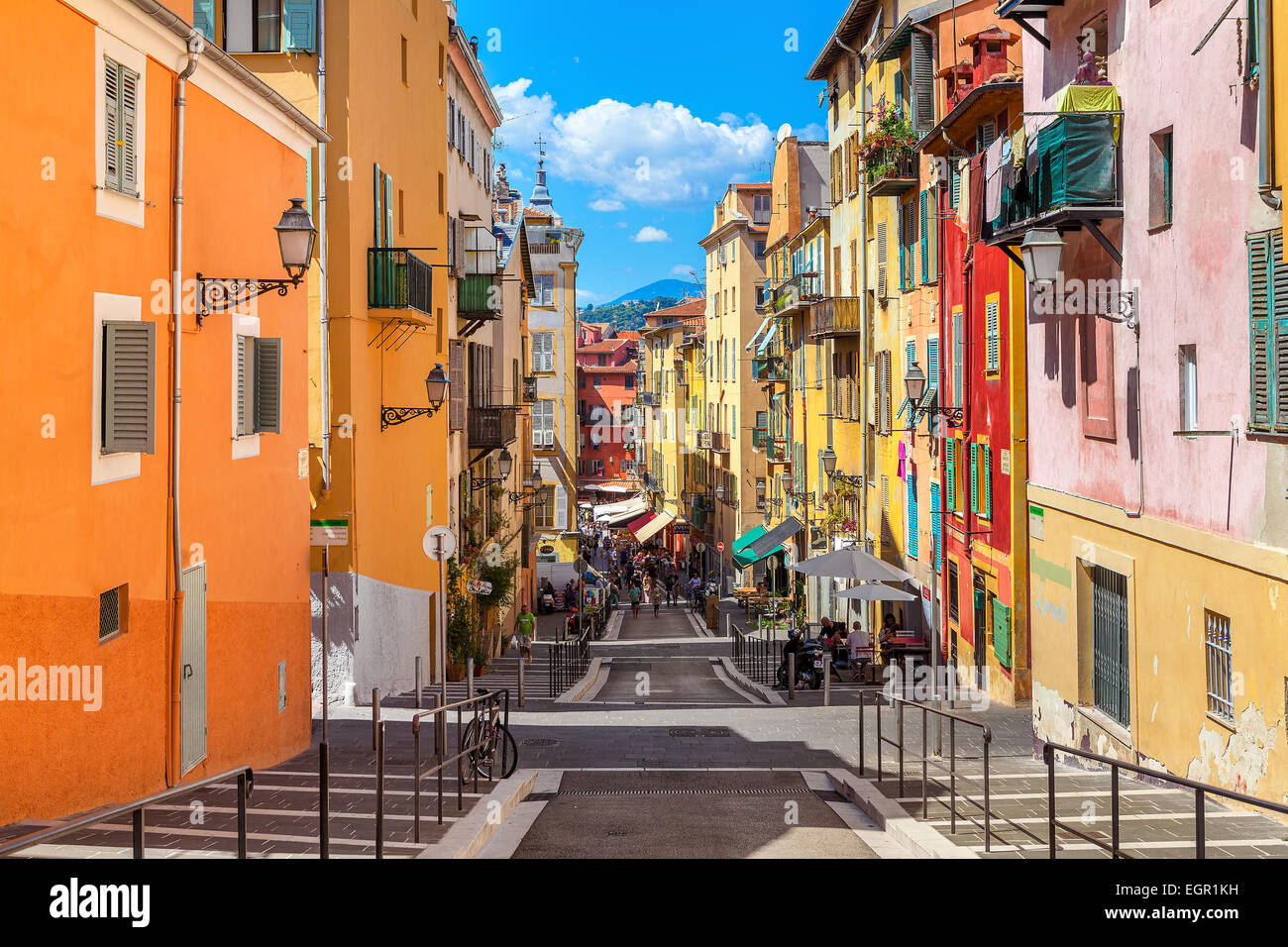 Narrow street in old tourist part of Nice, France. - Stock Image