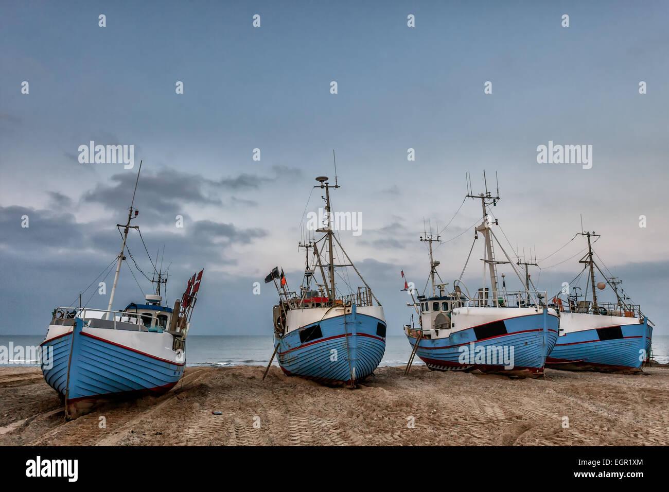 Fishing boats on land at Thorup beach on the Danish North Sea coast - Stock Image