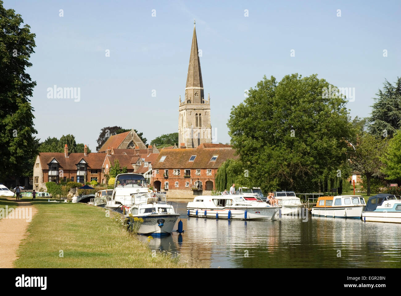 Berks - Abingdon - river Thames - pleasure boats  - backdrop town rooftops + C13 steeple of St Helen's church - Stock Image