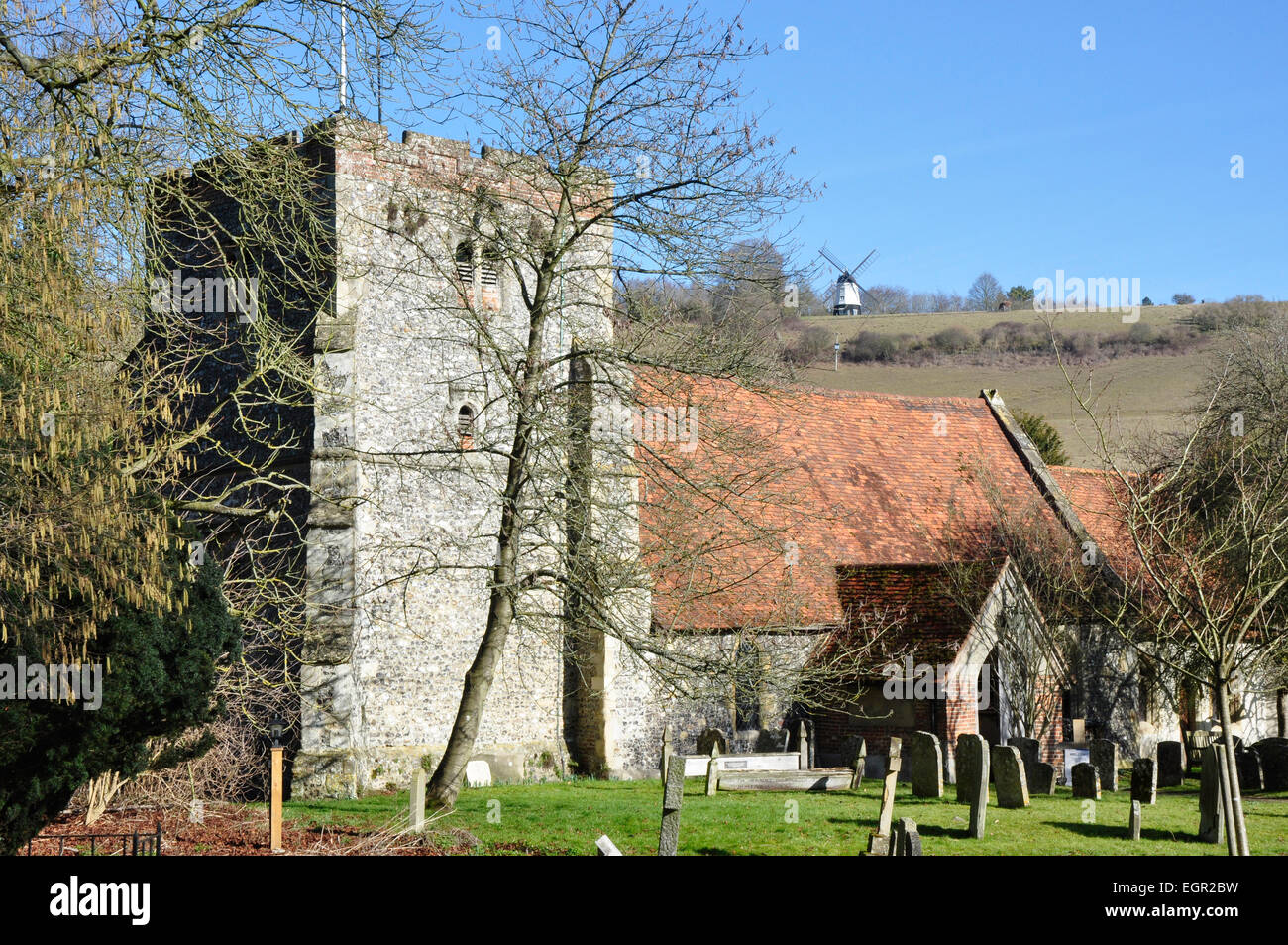 Bucks - Chiltern Hills -ancient  Turville village church - backdrop of Cobstone Hill and famous windmill - early - Stock Image
