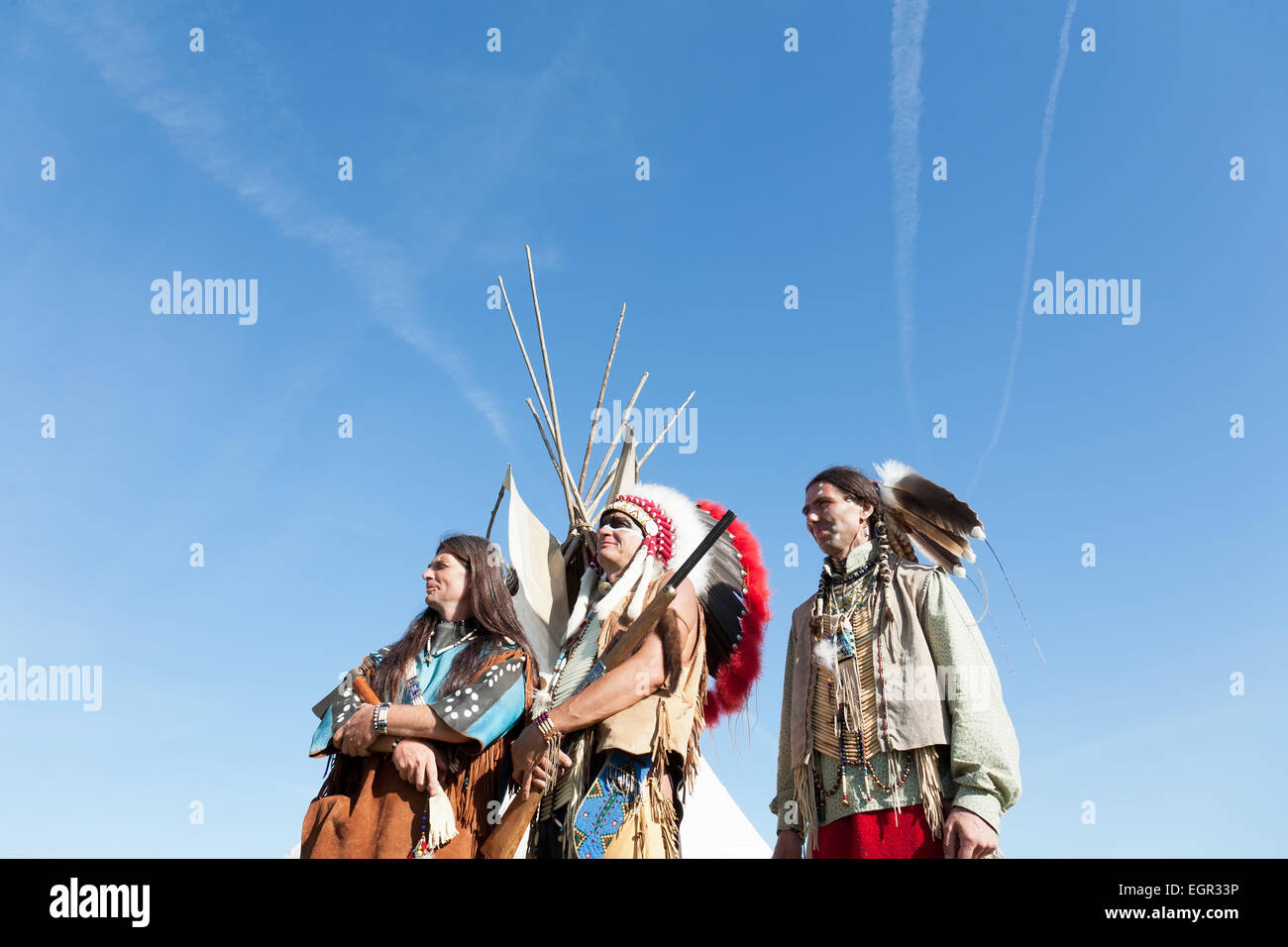 Group of North American Indians against the blue sky - Stock Image