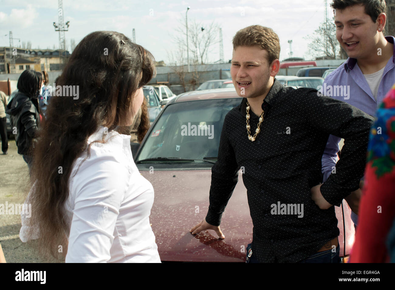 A young girl and a boy chatting in Brode Market. The annual gathering of the Thracian tinkers (Kalaidzhii) on the - Stock Image