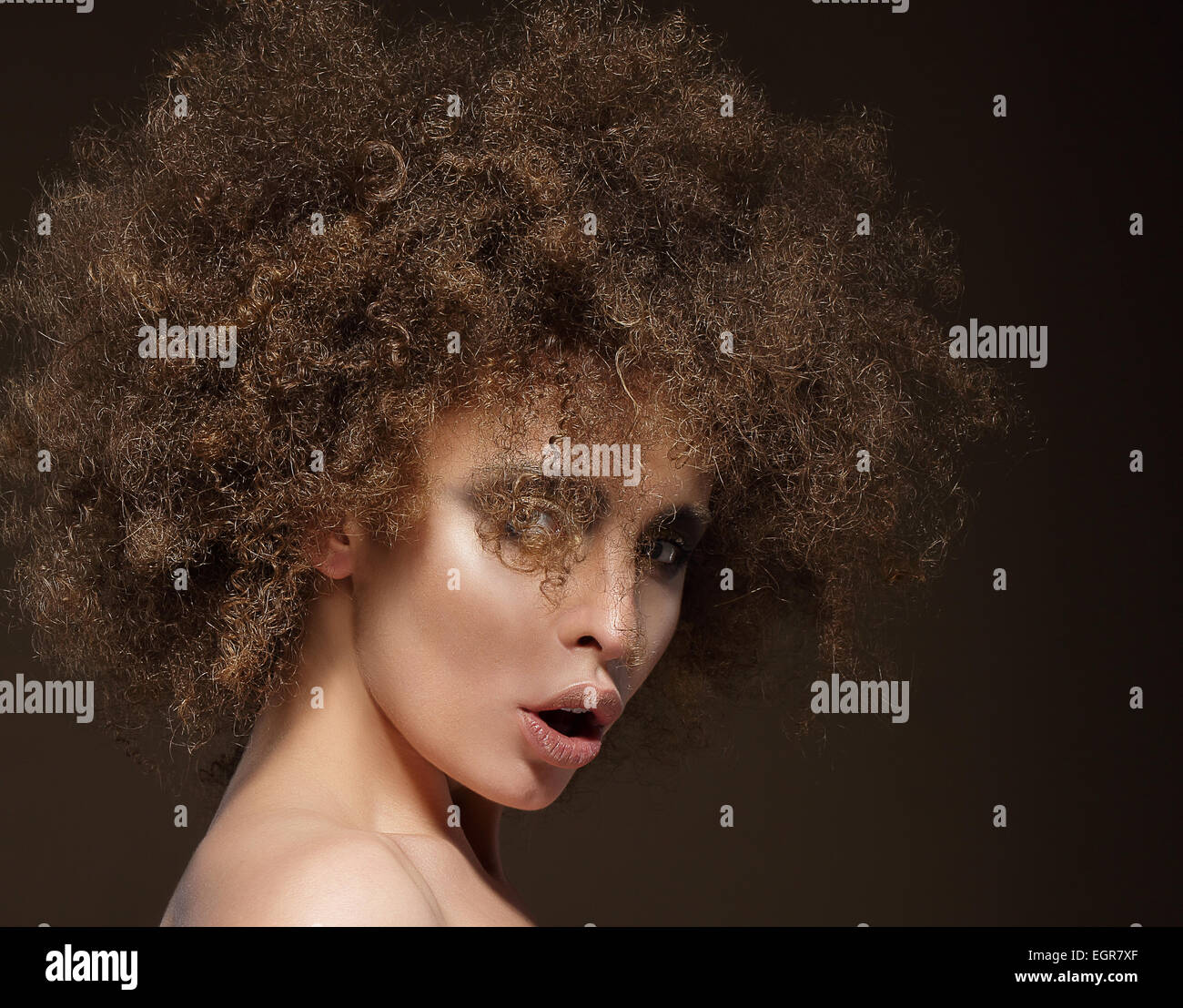 Trendy Charismatic Woman with Frizzy Hairdo - Stock Image