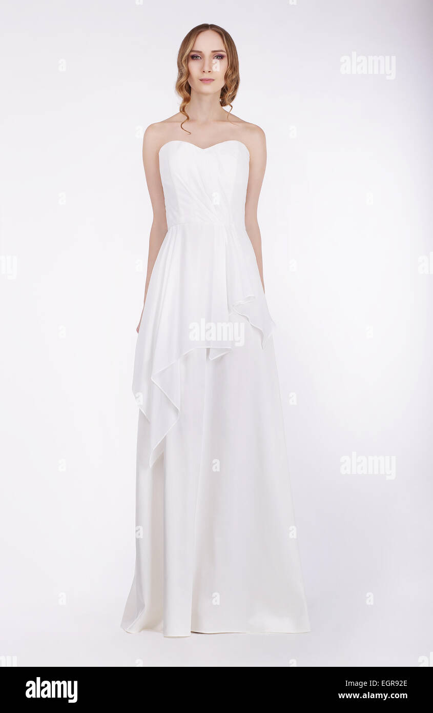 Fashion Model Standing in Long White Dress - Stock Image