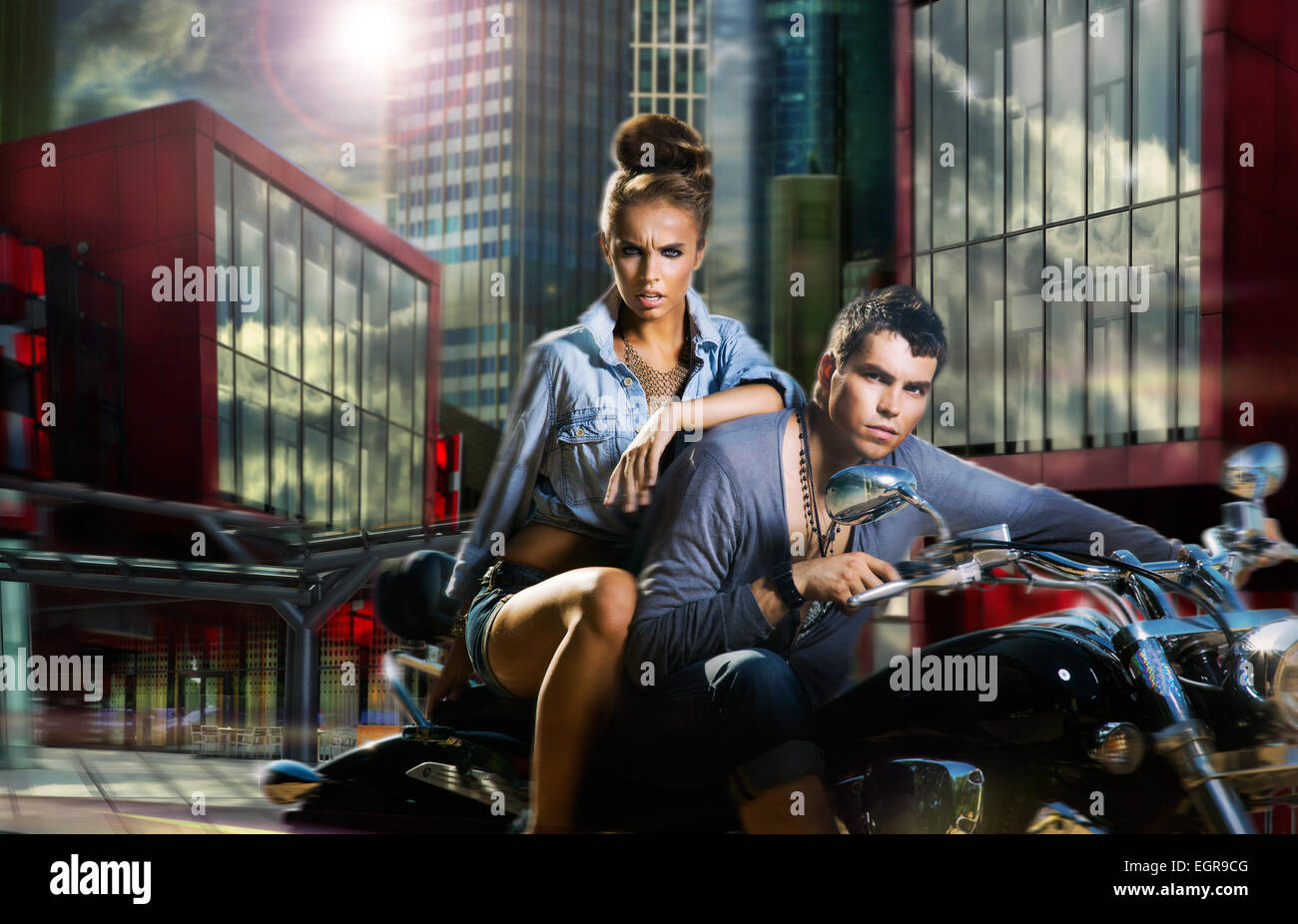 Adventure. A Couple Riding A Motorcycle - Stock Image