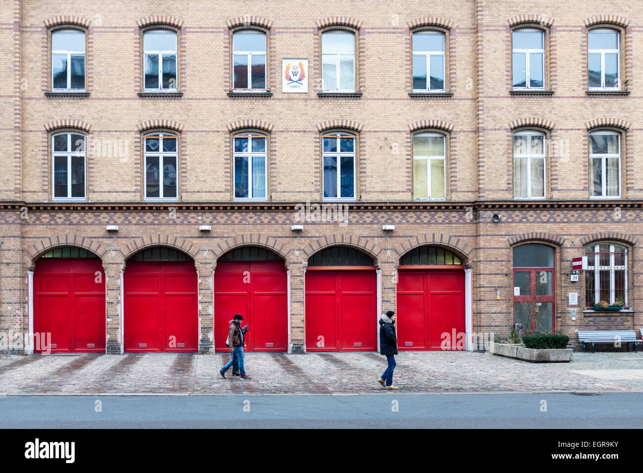 Berlin old fire station (1883) still operational - brick building with red doors in Oderberger strasse, Prenzlauerberg, - Stock Image