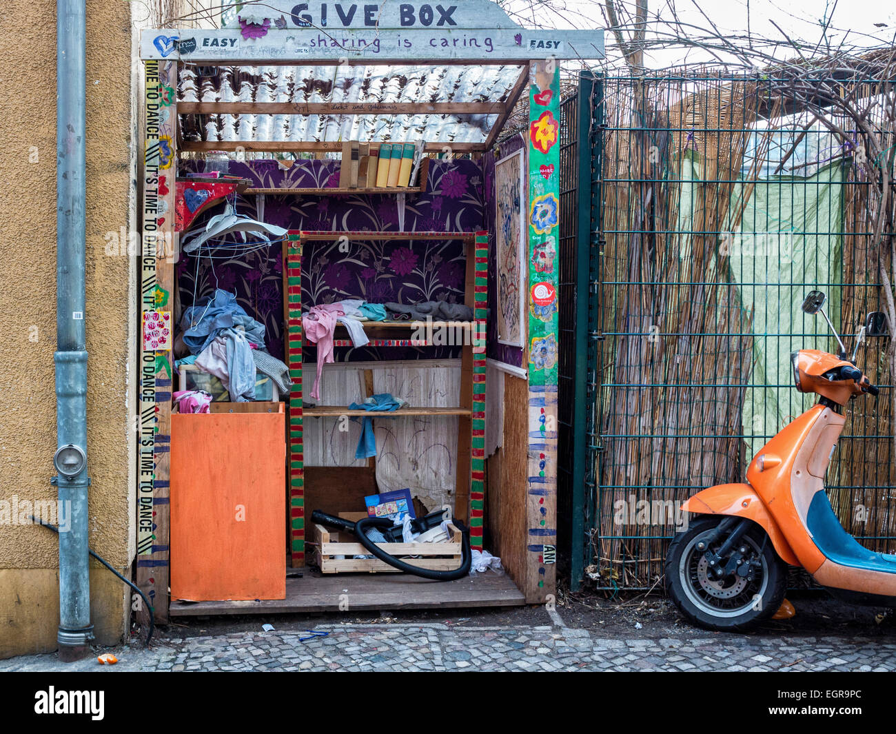 Berlin street charity box - a donations area to donate goods and clothing for the less privileged - Stock Image