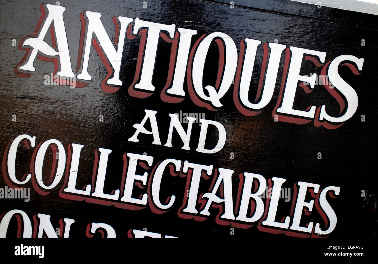 Antiques and collectables sign outside an antiques shop - Stock Image