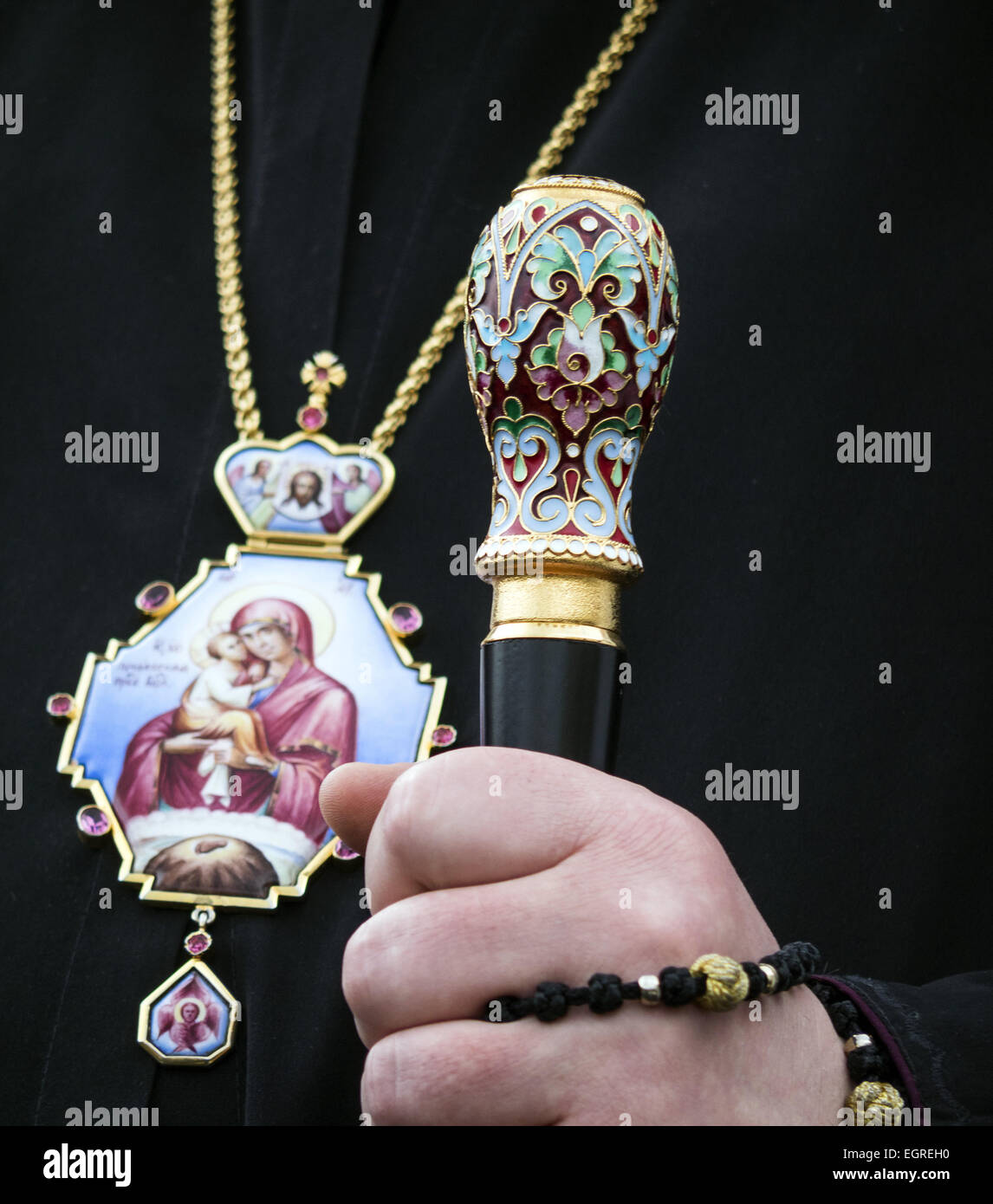 March 1, 2015 - Catholic priest holding a stick -- Activists demand the release of Ukrainian government forces pilot - Stock Image