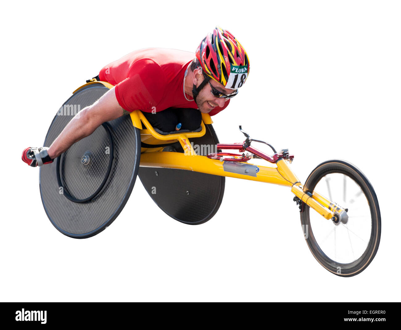 Disabled athlete taking part in the London marathon wheelchair race on a white background - Stock Image