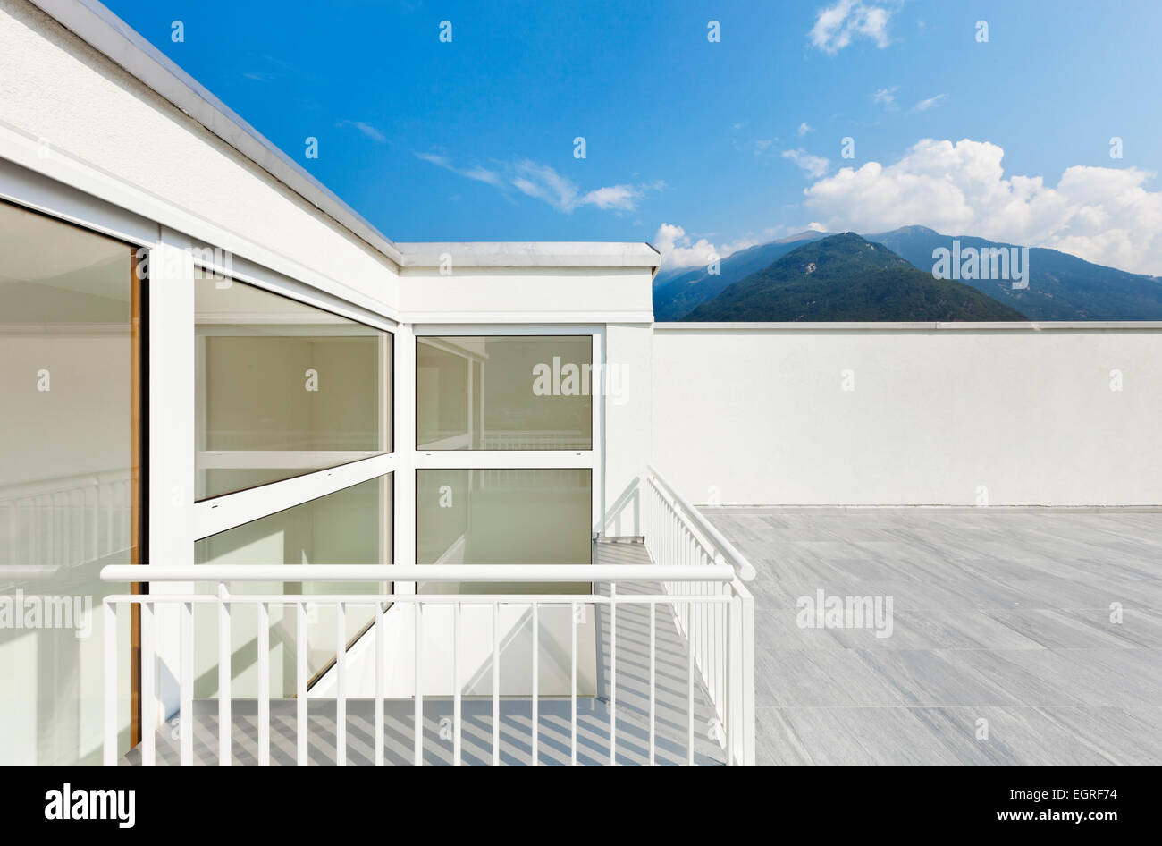 large terrace of a modern white house - Stock Image