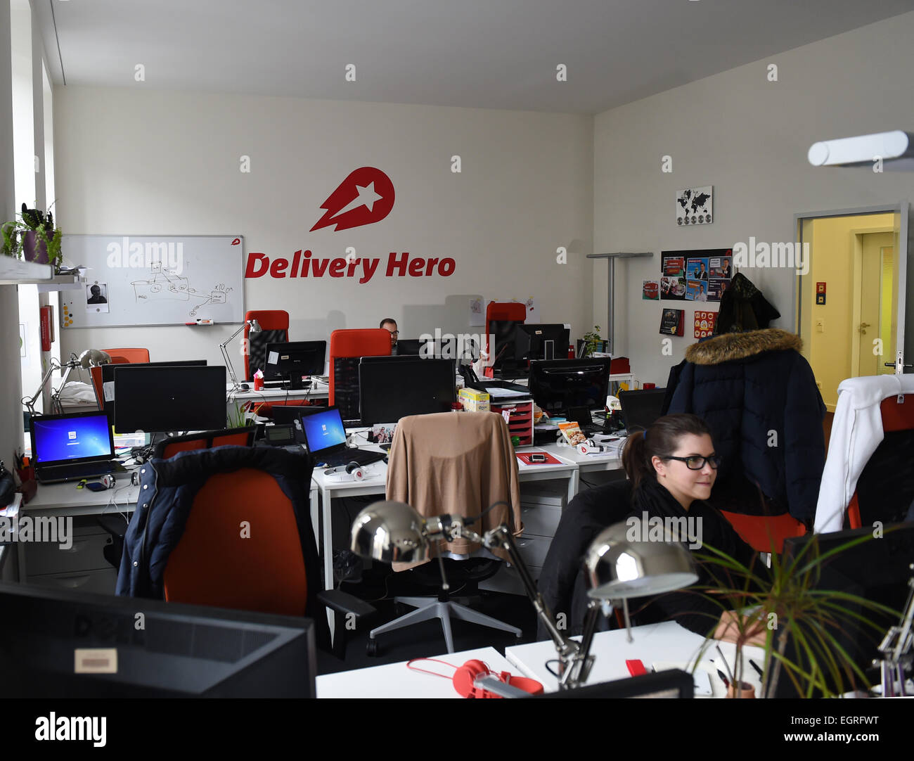 Berlin, Germany. 24th Feb, 2015. Staff members work on their workstations in the headquarter of online order and - Stock Image