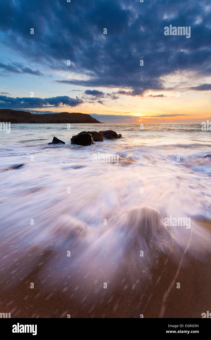 Large waves torment the beach of Dail Mor on the west coast of the Isle of Lewis. - Stock Image
