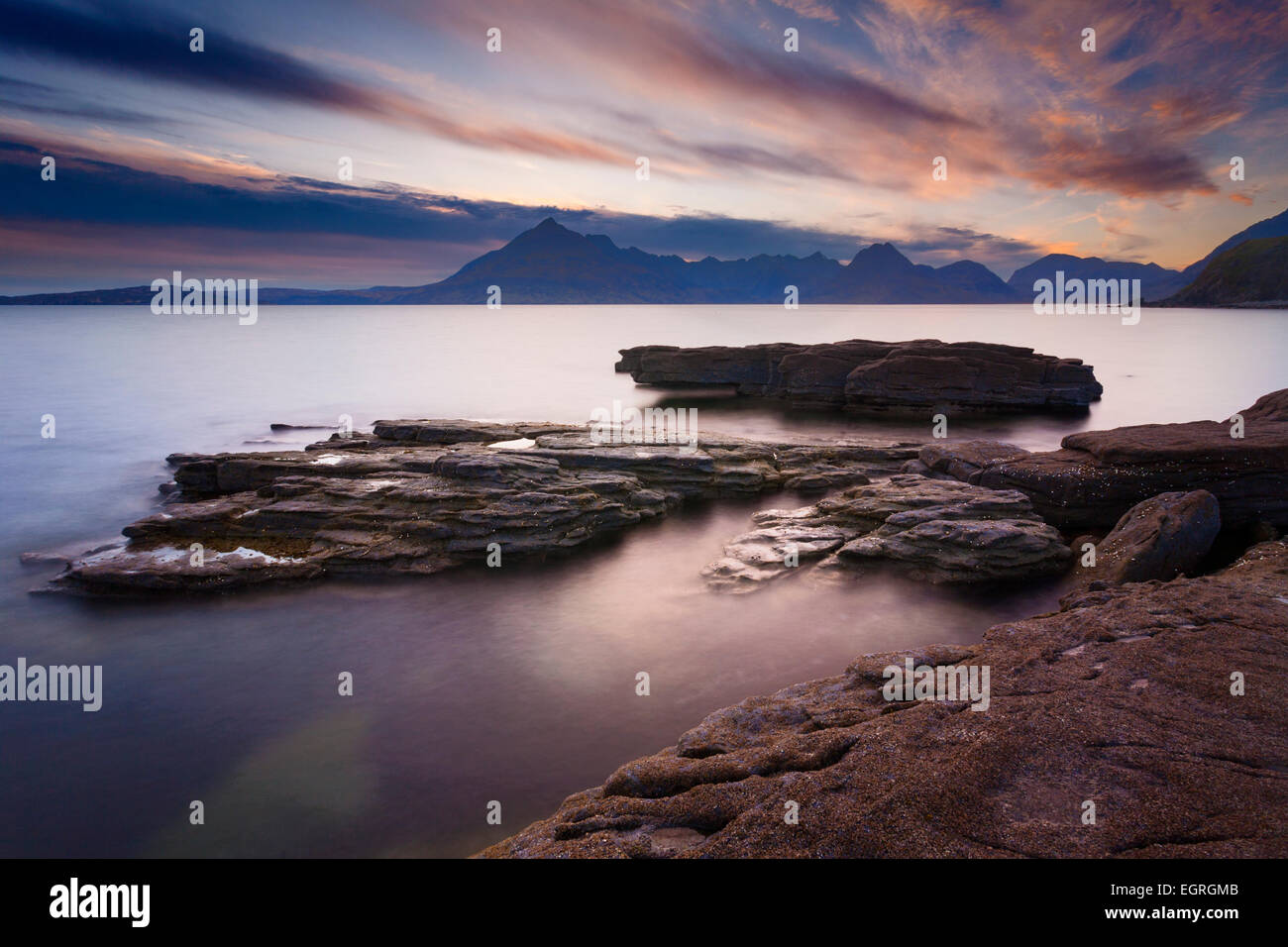 Classic view over the Black Cuillin hills from Elgol, Isle of Skye. This was taken just after sunset. - Stock Image