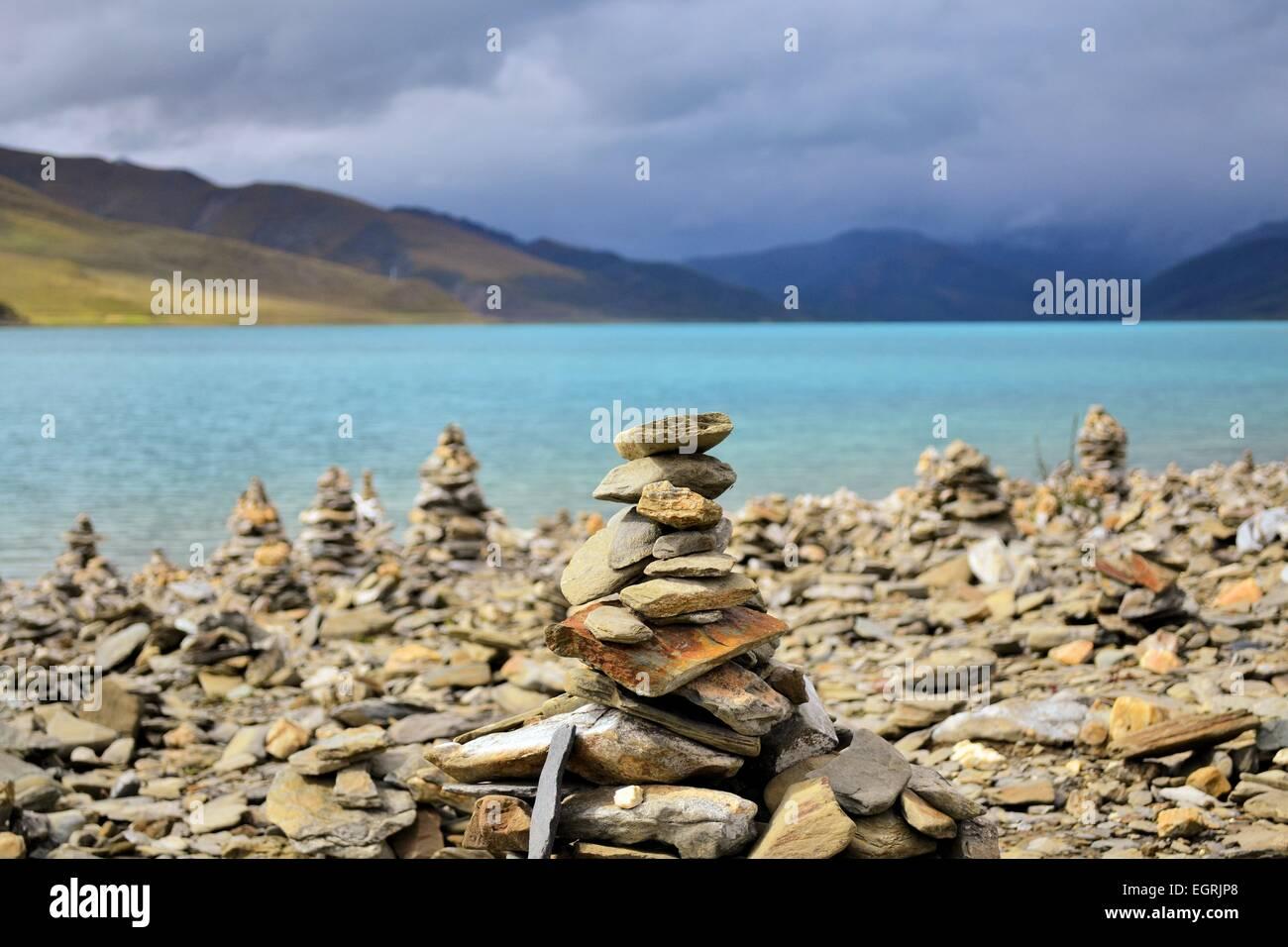 Mani stone heaps at Namtso Lake, Tibet Stock Photo