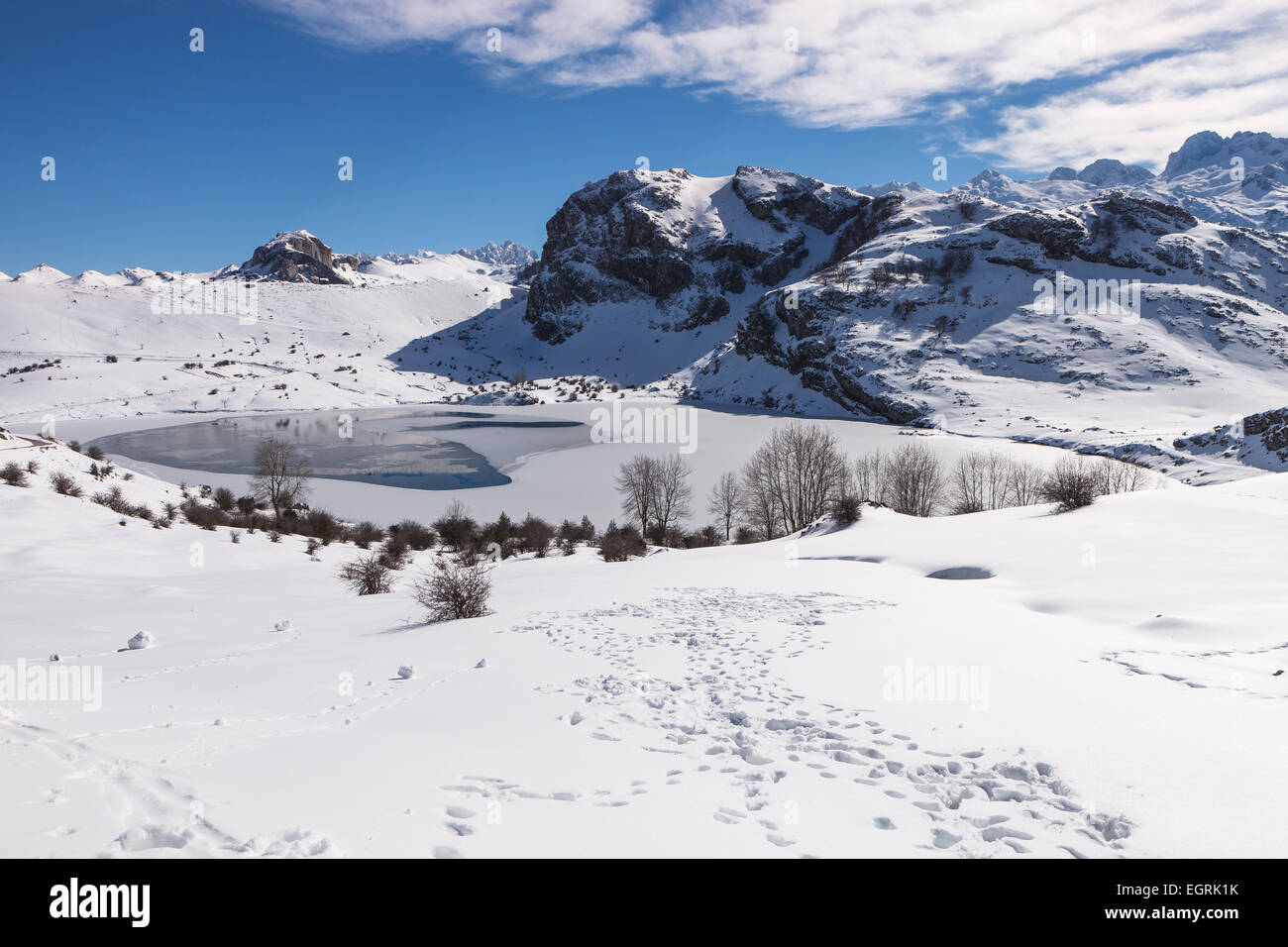 Semi frozen Enol Lake, in Covadonga, in the Picos de Europa National Park, Asturias, Spain. - Stock Image