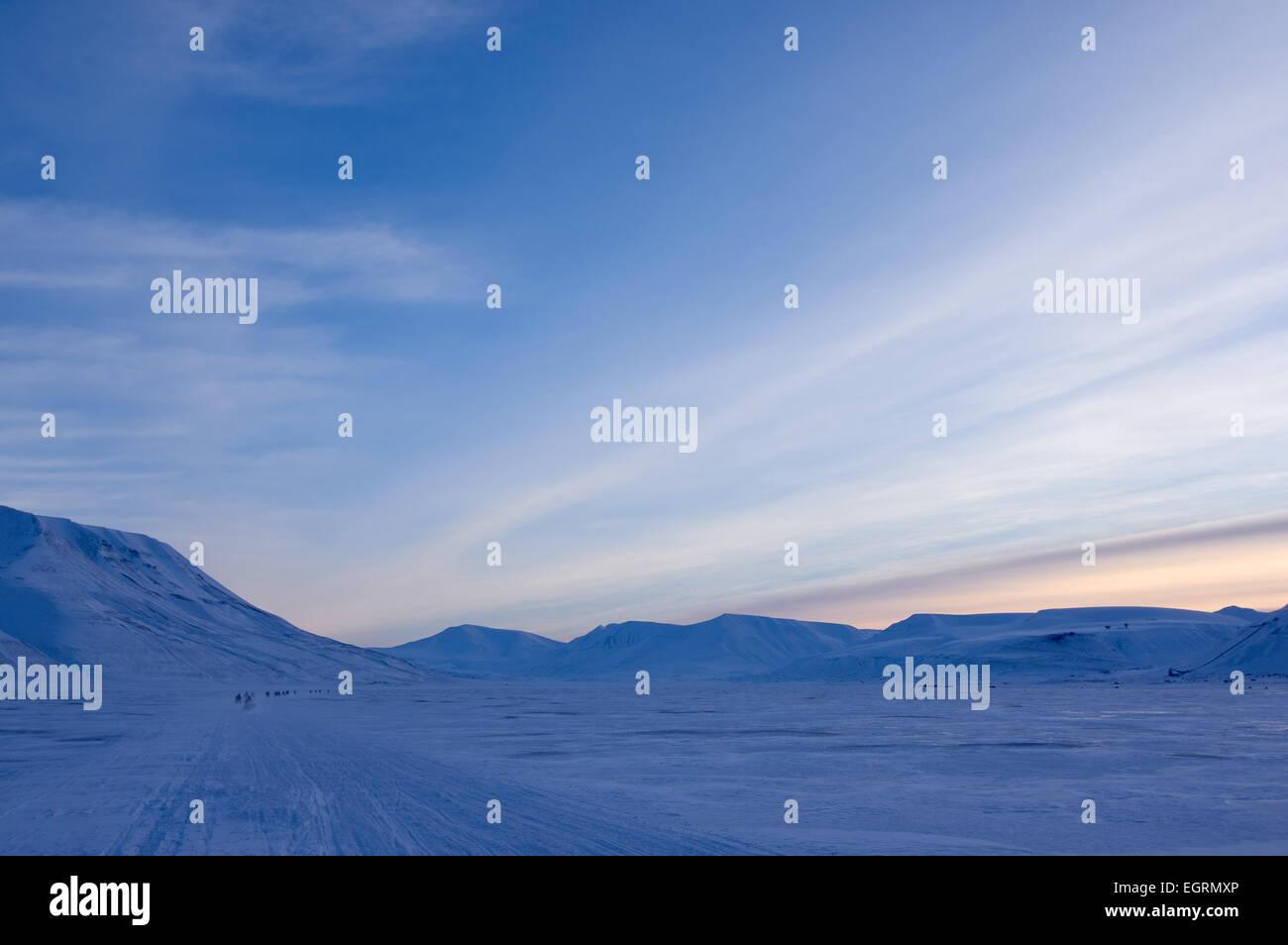 Snowmobile safari in Adventdalen, Svalbard - Stock Image