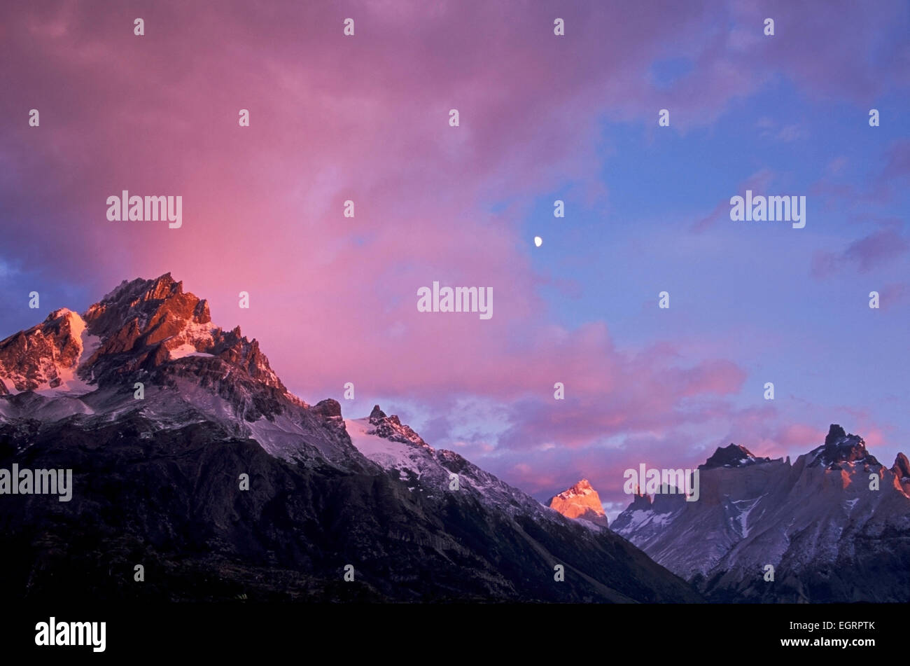 Moon over Bariloche Peak (L, 8,530 ft.), Torres del Paine National Park, Patagonia, Chile - Stock Image