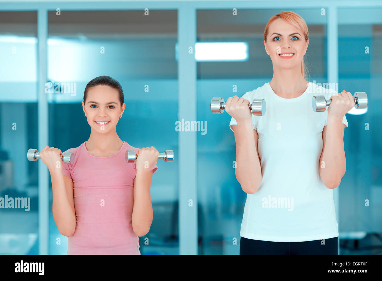 Mother and teenage girl at sports club - Stock Image